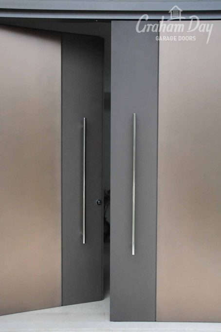 Pivot Door- Axolotl Bronze Smooth with a Cast Treasury Bronze Strip. & Graham Day Garage Doors - Image Gallery | View Image